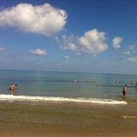 Photo taken at Rethymno Beach by Алексей Ф. on 9/23/2012