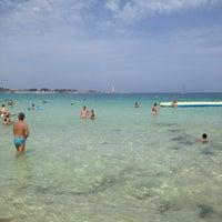 Photo taken at Spiaggia San Vito Lo Capo by Emanuele B. on 8/27/2013