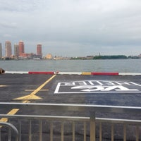 Photo taken at East 34th Street Heliport (TSS) by Corina R. on 6/11/2014