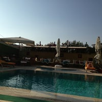 Photo taken at Pacific Hotel by Müge K. on 8/30/2013