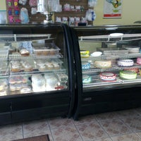 Photo taken at D'Nellys Bakery by Cayo I. on 3/13/2013