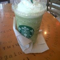 Photo taken at Starbucks by Alex W. on 11/24/2012