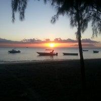 Photo taken at Mont Choisy Beach by Fabrice L. on 9/29/2012