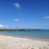 Photo taken at Mont Choisy Beach by Clyde B. on 5/15/2013