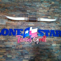 Photo taken at Lone Star Texas Grill by Arvid B. on 3/17/2014
