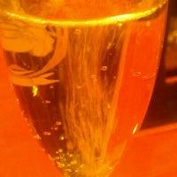 Photo prise au The Wine Den par Sean M. le12/23/2012
