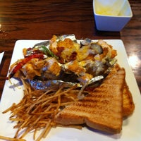 Photo taken at Four Brothers Seafood & Steakhouse by Jamie S. on 3/13/2014