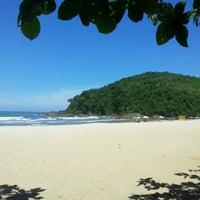 Photo taken at Praia Itamambuca by Karine N. on 3/4/2013