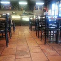 Photo taken at Delicias Bakery Restaurant by Calvin X. on 1/15/2014
