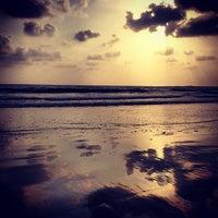 Photo taken at Morjim Beach by Sergey R. on 4/15/2013
