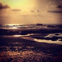 Photo taken at Morjim Beach by Sergey R. on 4/9/2013