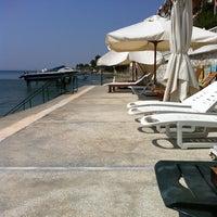 Photo taken at Sefa Taş Plajı by Anıl B. on 8/13/2013