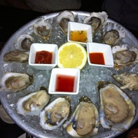 Photo taken at Flex Mussels by Princess Abigail B. on 11/10/2012