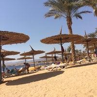 Photo taken at Beach at Reef Oasis Blue Bay Resort by Nataliya on 2/15/2014