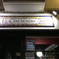 Photo taken at El Colmado by A M. on 10/12/2012