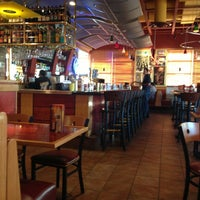 Photo taken at Red Robin Gourmet Burgers by Ron S. on 5/22/2013
