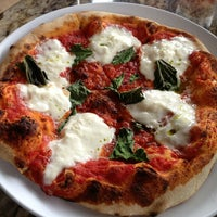 Photo taken at Olio Wood Fired Pizzeria by Michelle H. on 4/15/2013