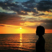 Photo taken at Pantai Lovina (Lovina Beach) by Alfi Habibah D. on 10/26/2012