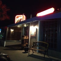 Photo taken at Pelican's Steak & Seafood by Lisa P. on 12/6/2012