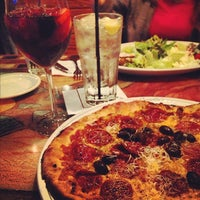 Photo taken at Carrabba's Italian Grill by Miguel G. on 11/30/2012