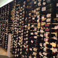 Photo taken at Crush Wine & Spirits by Badma I. on 11/28/2013