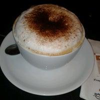 Photo taken at Caffé Nero by Zeynep Y. on 5/10/2013