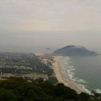 Photo taken at Costão da Praia do Santinho by Luck B. on 10/28/2012
