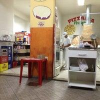 Photo taken at Padaria & Pizzaria Periquito by Sidnei V. on 1/31/2013