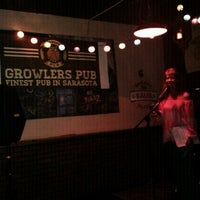 Photo taken at Growler's Pub by Evie T. on 2/22/2013