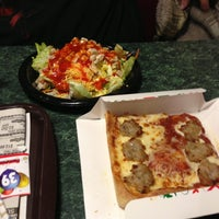 Photo taken at Rocky Rococo Pan Style Pizza by Amber L. on 3/3/2013