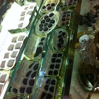 Photo taken at Mama Ganache Artisan Chocolate by Amanda P. on 11/9/2012
