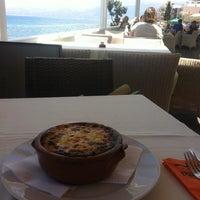 Photo taken at Palmera Seaside Restaurant by Павел К. on 5/10/2013