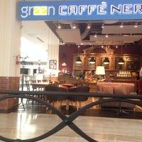 Photo taken at Green Caffè Nero by Adam M. on 4/23/2014