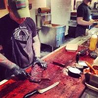 Photo taken at Mighty Quinn's BBQ by JamesCruickshank @. on 4/6/2013