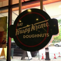 Photo taken at Krispy Kreme Doughnuts by Fabrienne A. on 5/10/2013