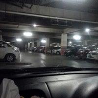 Photo taken at Parkiran pakuwon supermall by Erica C. on 6/19/2013