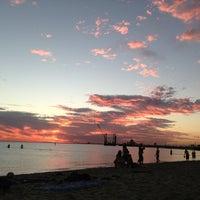 Photo taken at St Kilda Beach by Angelique K. on 3/6/2013