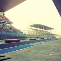 Photo taken at Buddh International Circuit by Juliette E. on 10/16/2012
