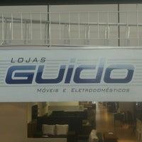 Photo taken at Lojas Guido 4 by Alberto N. on 5/3/2013