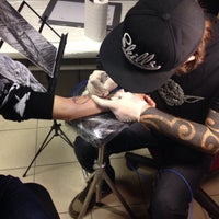 Photo taken at Revolt Tattoo Kustom by Dmitry C. on 12/1/2014