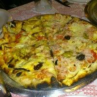 Photo taken at Roda Viva Pizzaria by Tatiana S. on 11/2/2012
