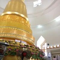Photo taken at Wat Phra Si Mahathat by Phoo N. on 4/16/2013