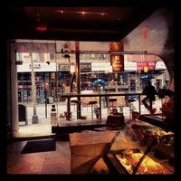 Photo taken at Juan Valdez Café by Crystal O. on 12/8/2012
