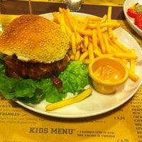 Photo taken at Hangar Burger by Valentina R. on 1/28/2014