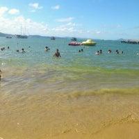 Photo taken at Praia de Laranjeiras by Romina J. on 2/1/2013