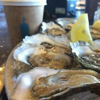 Photo taken at Hog Island Oyster Co. by Erica C. on 3/24/2013
