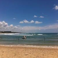 Photo taken at Leonardo Beach by Lapteva A. on 5/16/2013