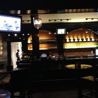 Photo taken at Earls Restaurant by Marc L. on 10/8/2012