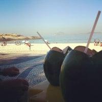 Photo taken at Ipanema Beach by João Guilherme T. on 7/14/2013