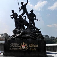 Photo taken at National Monument (Tugu Negara) by Kok Hui L. on 5/5/2014